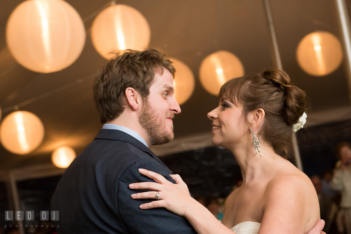 Bride and Groom smiling while doing first dance. Kent Island Maryland Matapeake Beach wedding reception party and romantic session photo, by wedding photographers of Leo Dj Photography. http://leodjphoto.com