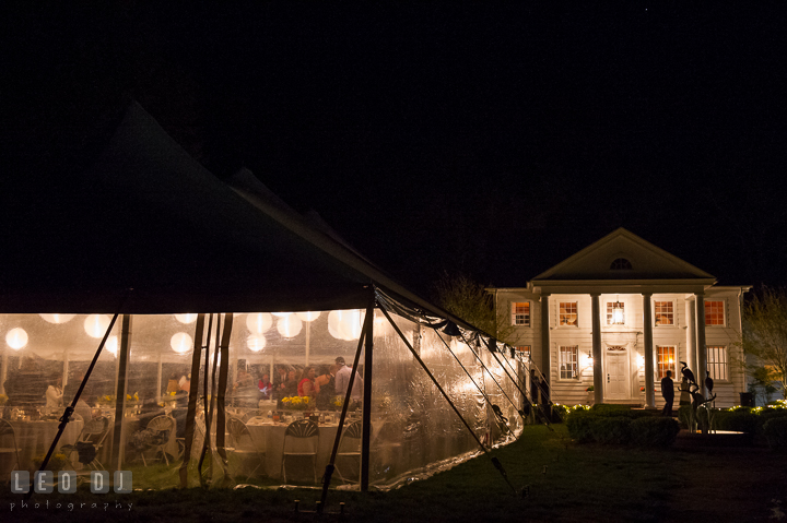 Evening view of the Clubhouse and tent at the venue. Kent Island Maryland Matapeake Beach wedding reception party and romantic session photo, by wedding photographers of Leo Dj Photography. http://leodjphoto.com