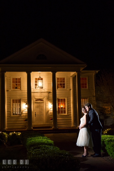 Bride and Groom hugging in front of the venue's Clubhouse. Kent Island Maryland Matapeake Beach wedding reception party and romantic session photo, by wedding photographers of Leo Dj Photography. http://leodjphoto.com