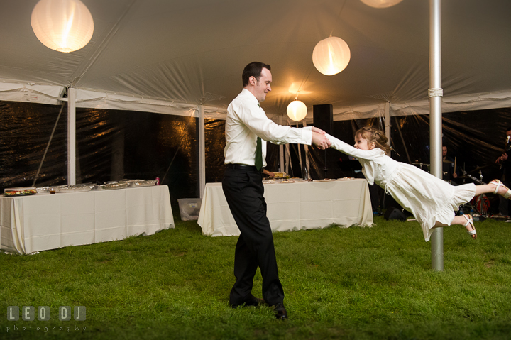Guests swinging the flower girl high while dancing. Kent Island Maryland Matapeake Beach wedding reception party and romantic session photo, by wedding photographers of Leo Dj Photography. http://leodjphoto.com