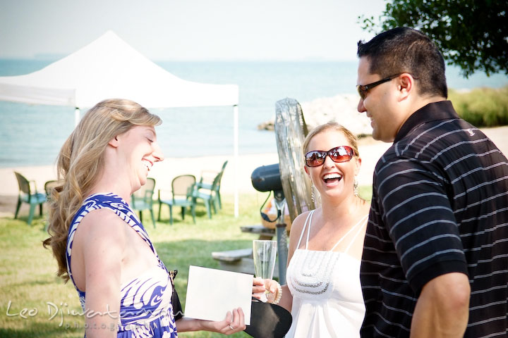 Bride laughing with guests. Cove Creek Country Club, Stevensville, Kent Island, Eastern Shore, Maryland Wedding Photographer, beach wedding photographer