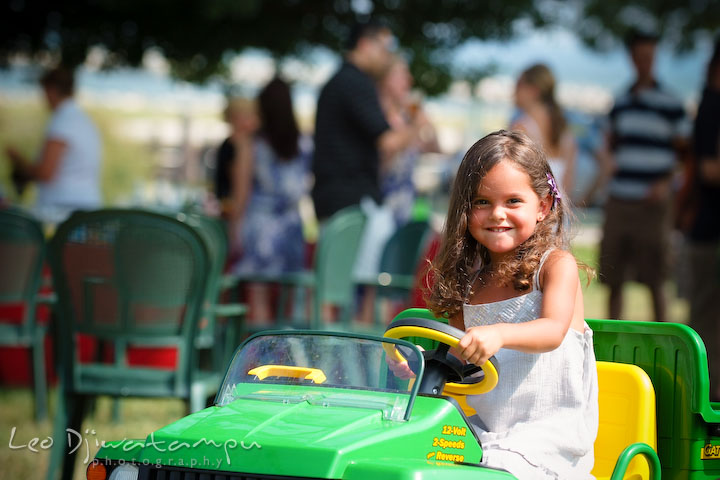 little girl playing and driving small John Deere car truck. Cove Creek Country Club, Stevensville, Kent Island, Eastern Shore, Maryland Wedding Photographer, beach wedding photographer