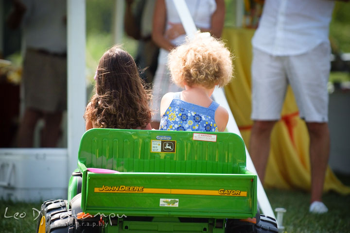 two girls driving small John Deere truck. Cove Creek Country Club, Stevensville, Kent Island, Eastern Shore, Maryland Wedding Photographer, beach wedding photographer