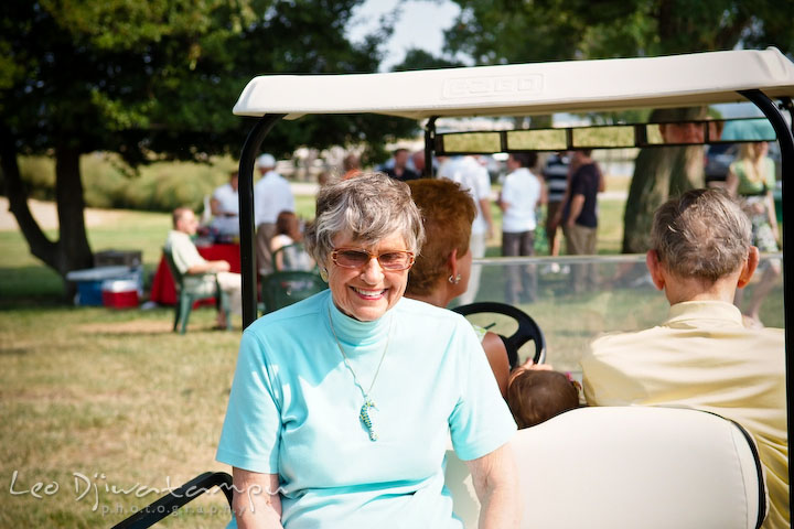Guests ride on a golfcart. Cove Creek Country Club, Stevensville, Kent Island, Eastern Shore, Maryland Wedding Photographer, beach wedding photographer