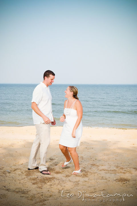 Bride and groom laughing and playing on the beach. Cove Creek Country Club, Stevensville, Kent Island, Eastern Shore, Maryland Wedding Photographer, beach wedding photographer