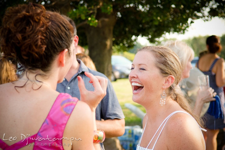 Bride laughing with another guest. Cove Creek Country Club, Stevensville, Kent Island, Eastern Shore, Maryland Wedding Photographer, beach wedding photographer