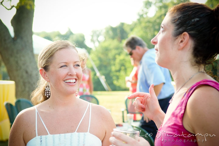 Bride talking to guest, smiling. Cove Creek Country Club, Stevensville, Kent Island, Eastern Shore, Maryland Wedding Photographer, beach wedding photographer