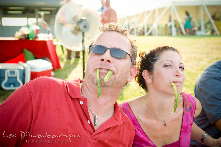 Two guests goofing around, hanging asparagus from their mouth. Cove Creek Country Club, Stevensville, Kent Island, Eastern Shore, Maryland Wedding Photographer, beach wedding photographer