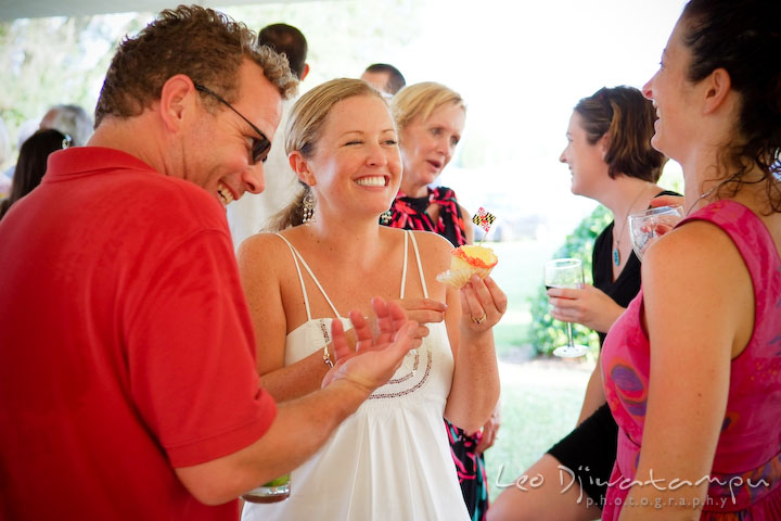 Bride laughing and having fun with guests. Cove Creek Country Club, Stevensville, Kent Island, Eastern Shore, Maryland Wedding Photographer, beach wedding photographer