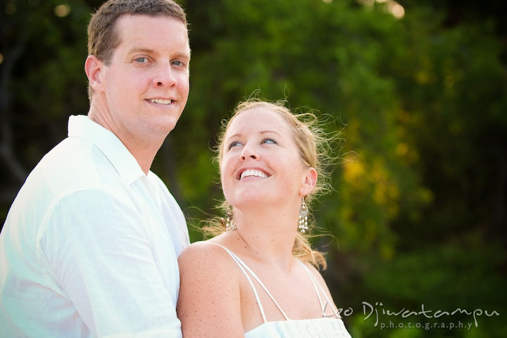 Bride cuddling and looking up at groom. Cove Creek Country Club, Stevensville, Kent Island, Eastern Shore, Maryland Wedding Photographer, beach wedding photographer