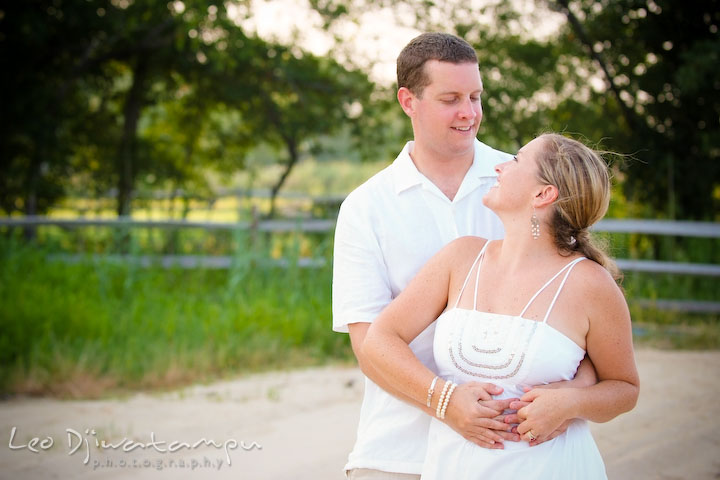 Bride and groom hugging and looking at each other. Cove Creek Country Club, Stevensville, Kent Island, Eastern Shore, Maryland Wedding Photographer, beach wedding photographer