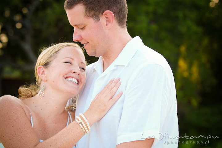 Bride and groom cuddling, laughing. Cove Creek Country Club, Stevensville, Kent Island, Eastern Shore, Maryland Wedding Photographer