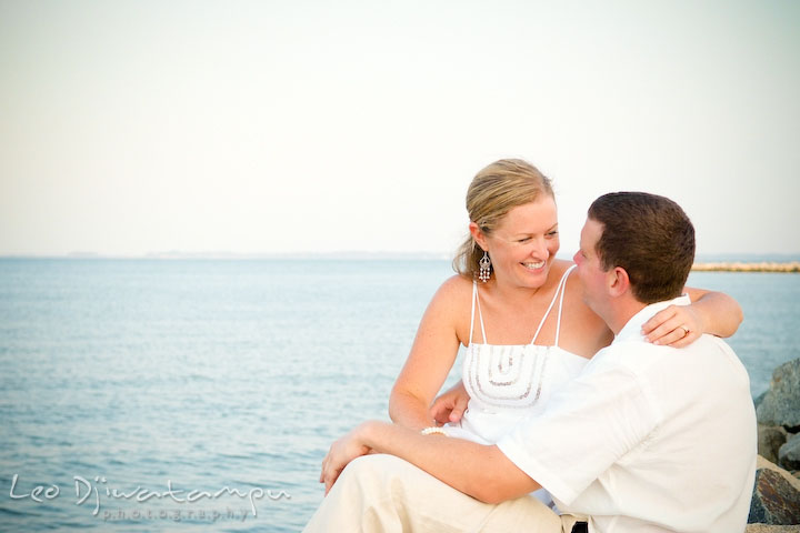 Bride and groom sitting on the rocks by the beach. Cove Creek Country Club, Stevensville, Kent Island, Eastern Shore, Maryland Wedding Photographer, beach wedding photographer