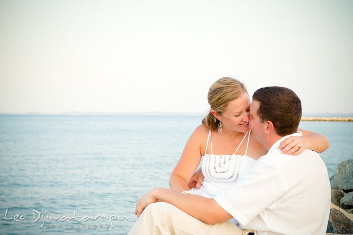 Bride and groom almost kiss, on the rocks on the beach. Cove Creek Country Club, Stevensville, Kent Island, Eastern Shore, Maryland Wedding Photographer, beach wedding photographer