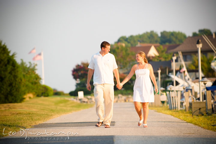 Bride and groom walking down together by the beach pier. Cove Creek Country Club, Stevensville, Kent Island, Eastern Shore, Maryland Wedding Photographer, beach wedding photographer