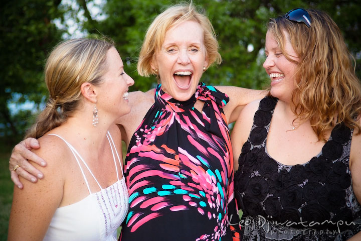 Bride laughing together with mother and sister. Cove Creek Country Club, Stevensville, Kent Island, Eastern Shore, Maryland Wedding Photographer, beach wedding photographer