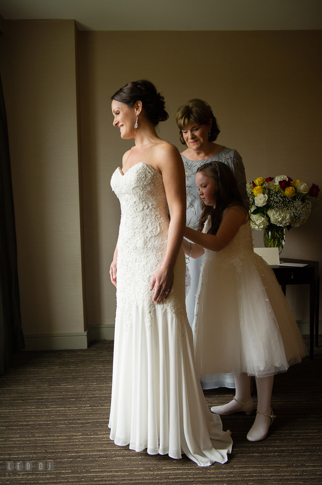 Westin Annapolis Hotel daughter and mother buttoning up bride's gown photo by Leo Dj Photography