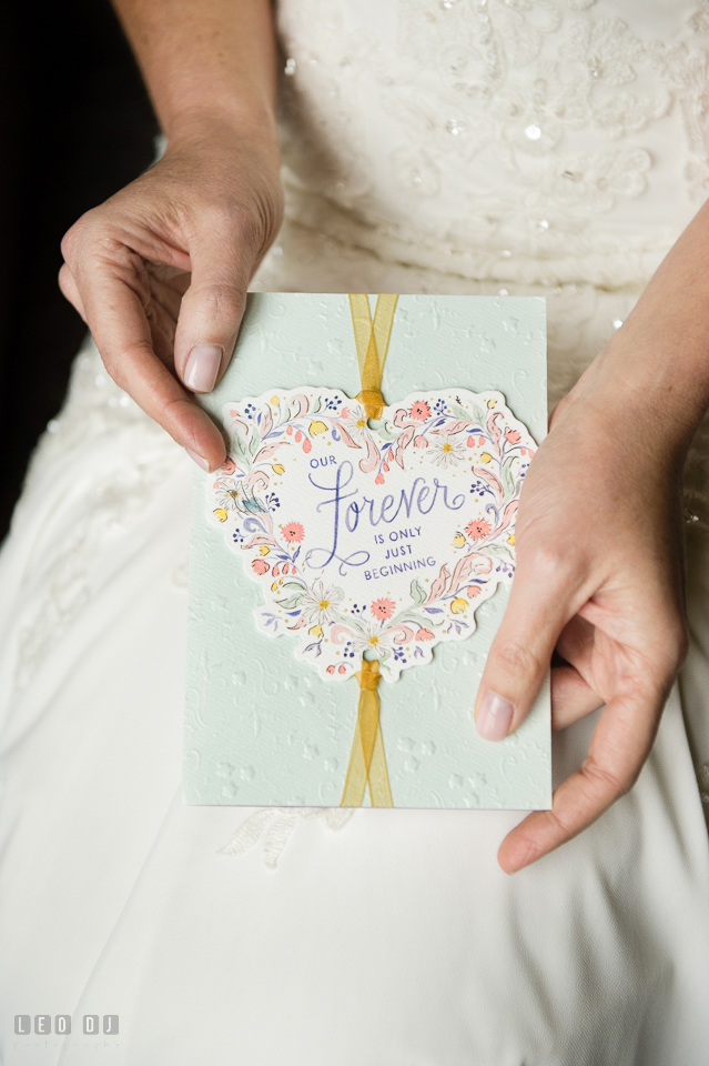 Westin Annapolis Hotel Bride holding card from groom photo by Leo Dj Photography