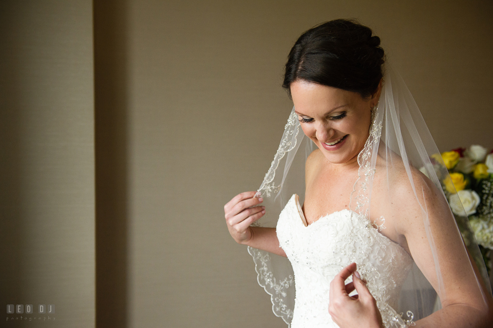 Westin Annapolis Hotel bride smiling holding veil photo by Leo Dj Photography