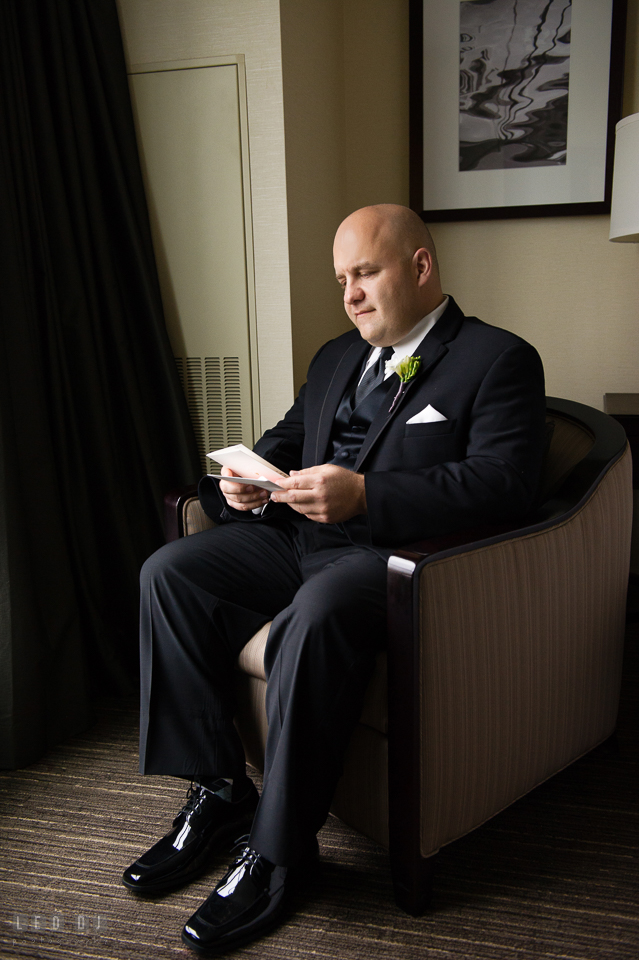 Westin Annapolis Hotel groom reading card from bride photo by Leo Dj Photography