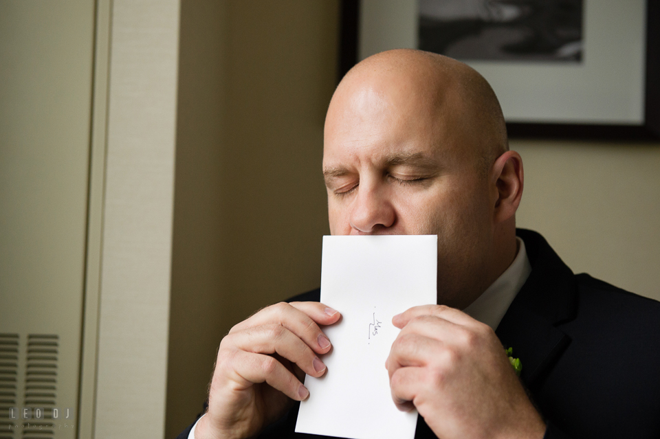 Westin Annapolis Hotel groom kissing card from bride photo by Leo Dj Photography