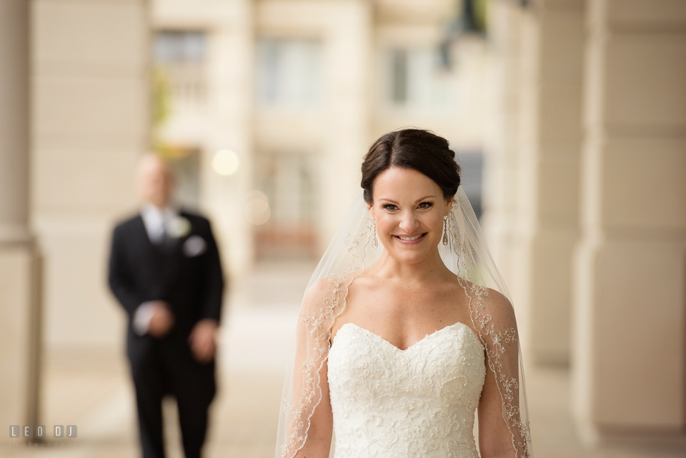 Westin Annapolis Hotel bride smiling as groom approaching during first look photo by Leo Dj Photography