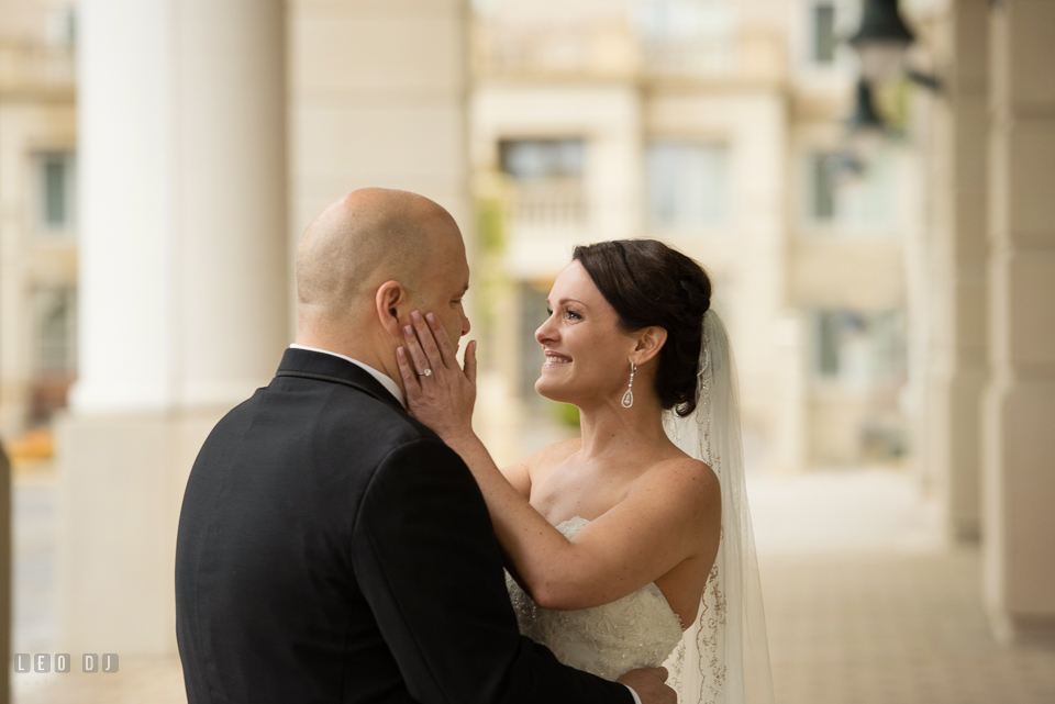 Westin Annapolis Hotel bride happy and holding groom's face during first look photo by Leo Dj Photography