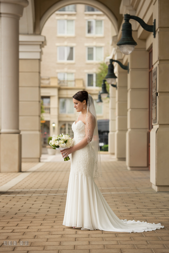 Westin Annapolis Hotel bride with wedding gown from Mary's Designer Bridal Boutique holding bouquet photo by Leo Dj Photography