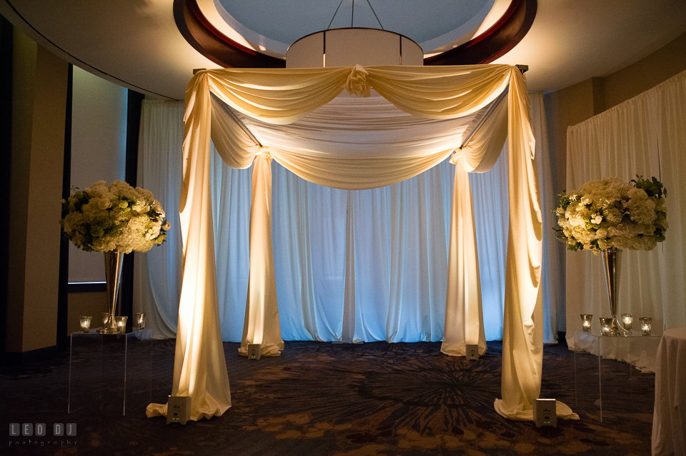 Westin Annapolis Hotel ceremony canopy with custom drapes and uplighting by Event Dynamics photo by Leo Dj Photography