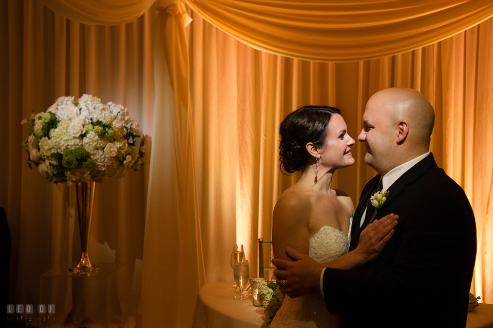 Westin Annapolis Hotel bride and groom cuddling by sweetheart table photo by Leo Dj Photography