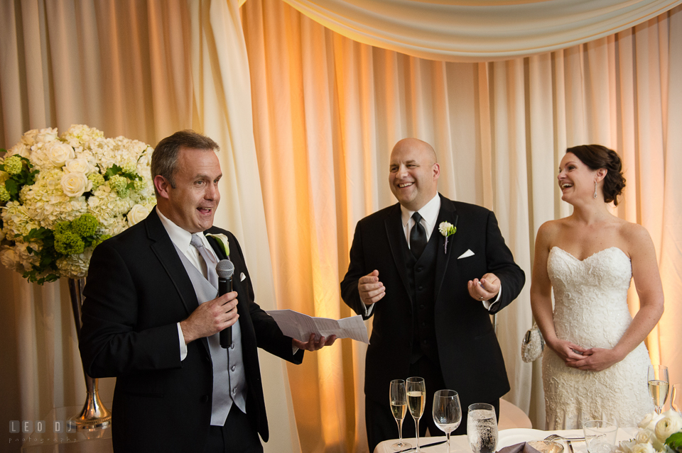 Westin Annapolis Hotel bride and groom laughing listening to speech from best man photo by Leo Dj Photography