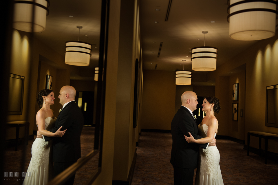 Westin Annapolis Hotel bride and groom holding each other in the hallway photo by Leo Dj Photography