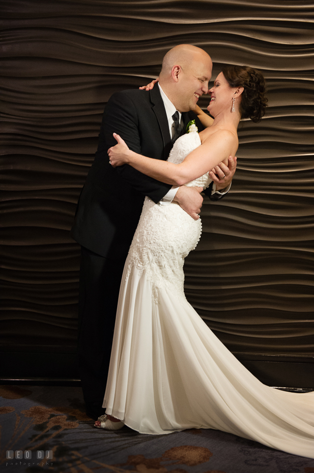 Westin Annapolis Hotel bride and groom laughing while doing semi dip photo by Leo Dj Photography