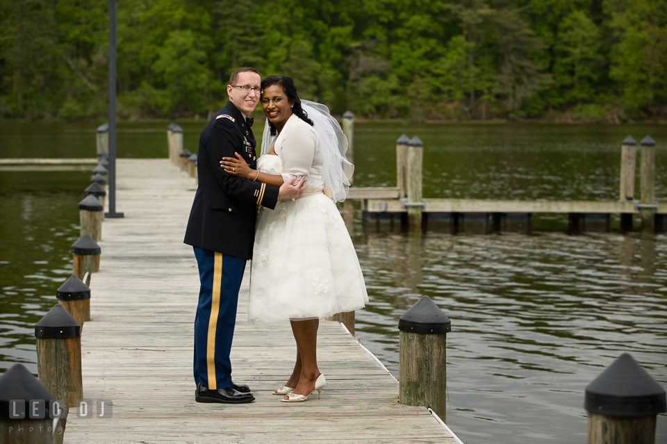 Bride and Groom posing by the water. Aspen Wye River Conference Centers wedding at Queenstown Maryland, by wedding photographers of Leo Dj Photography. http://leodjphoto.com