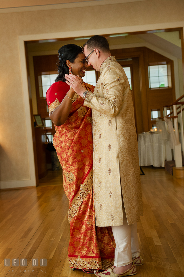 Bride and Groom wearing Indian outfit dancing close to each other. Aspen Wye River Conference Centers wedding at Queenstown Maryland, by wedding photographers of Leo Dj Photography. http://leodjphoto.com