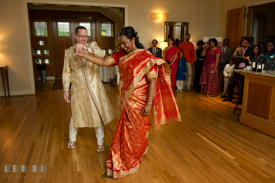 Groom twirling Bride during their first dance wearing Indian outfit. Aspen Wye River Conference Centers wedding at Queenstown Maryland, by wedding photographers of Leo Dj Photography. http://leodjphoto.com