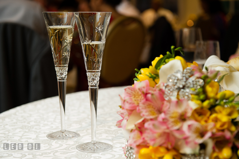 Champagne glasses and Bride's floral bouquet. Aspen Wye River Conference Centers wedding at Queenstown Maryland, by wedding photographers of Leo Dj Photography. http://leodjphoto.com