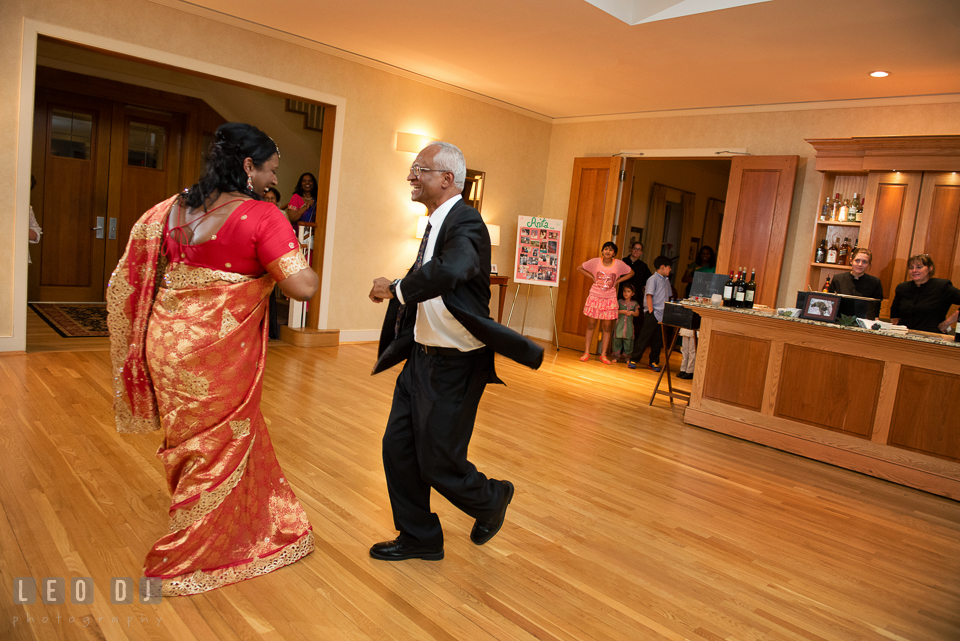 Bride and her Father dancing energetically during parent dance. Aspen Wye River Conference Centers wedding at Queenstown Maryland, by wedding photographers of Leo Dj Photography. http://leodjphoto.com