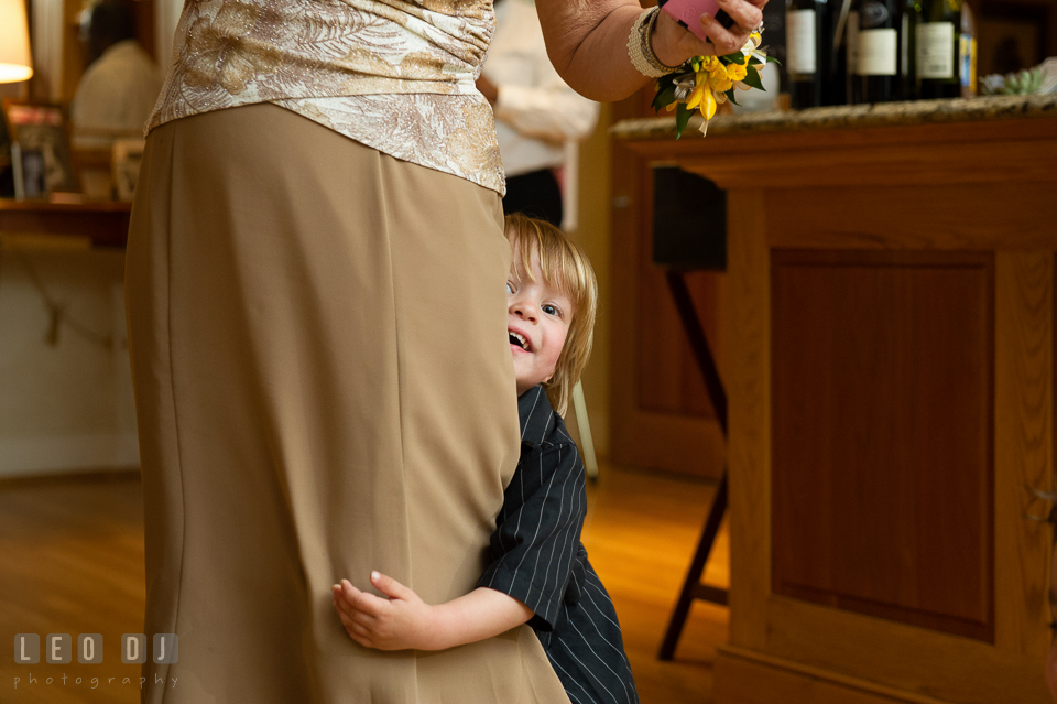 Boy hiding behind his Mother. Aspen Wye River Conference Centers wedding at Queenstown Maryland, by wedding photographers of Leo Dj Photography. http://leodjphoto.com