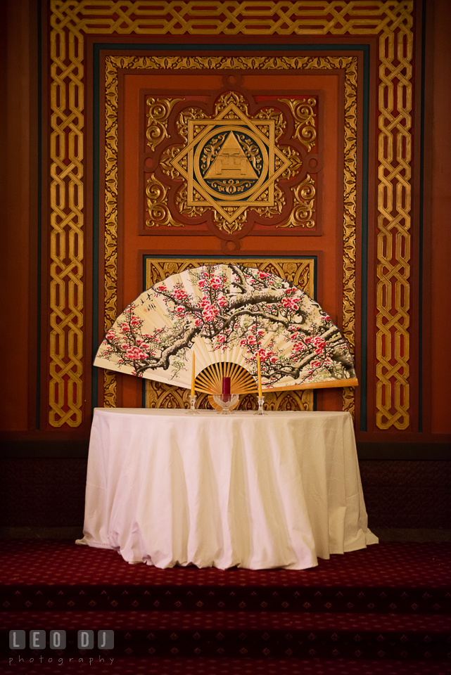 Unity candles and Chinese fan at the altar in the Oriental Room. Tremont Grand Historic Venue wedding, Baltimore, Maryland, by wedding photographers of Leo Dj Photography. http://leodjphoto.com