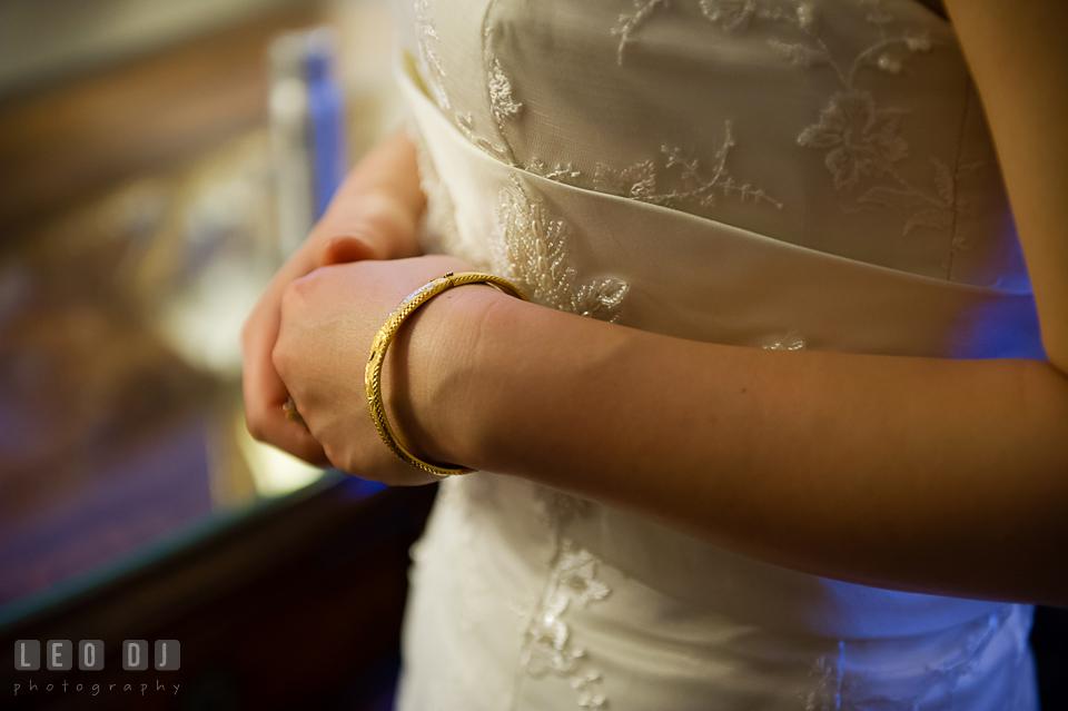 Bride wearing her golden bracelet. Tremont Grand Historic Venue wedding, Baltimore, Maryland, by wedding photographers of Leo Dj Photography. http://leodjphoto.com