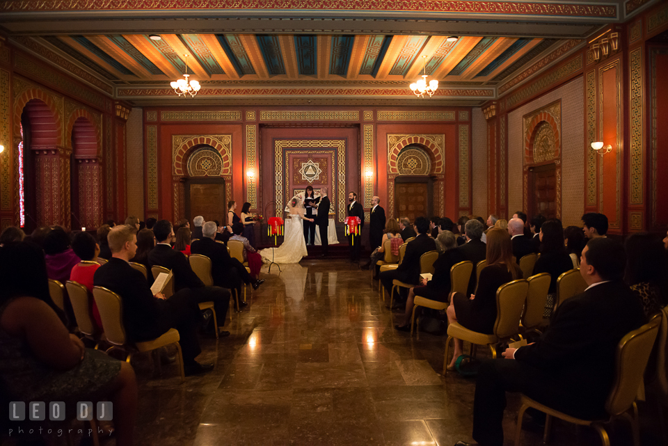 Bride and Groom during the ceremony by the altar in the Oriental Room. Tremont Grand Historic Venue wedding, Baltimore, Maryland, by wedding photographers of Leo Dj Photography. http://leodjphoto.com