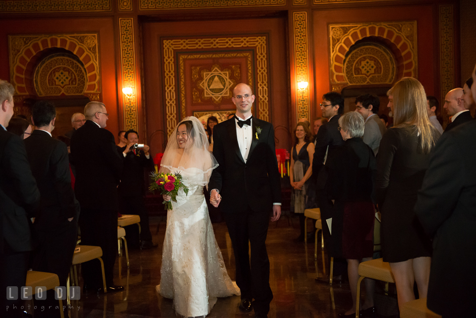 Bride and Groom walking out of the aisle during reception. Tremont Grand Historic Venue wedding, Baltimore, Maryland, by wedding photographers of Leo Dj Photography. http://leodjphoto.com