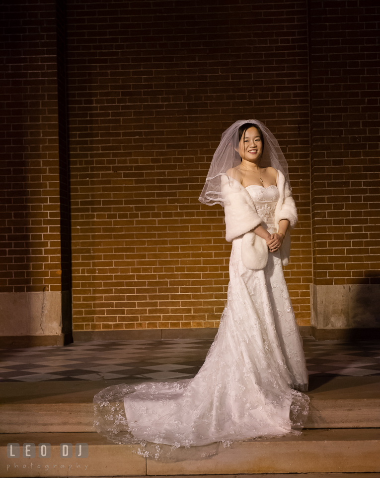 Bride posing and smiling with her beautiful wedding gown. Tremont Grand Historic Venue wedding, Baltimore, Maryland, by wedding photographers of Leo Dj Photography. http://leodjphoto.com