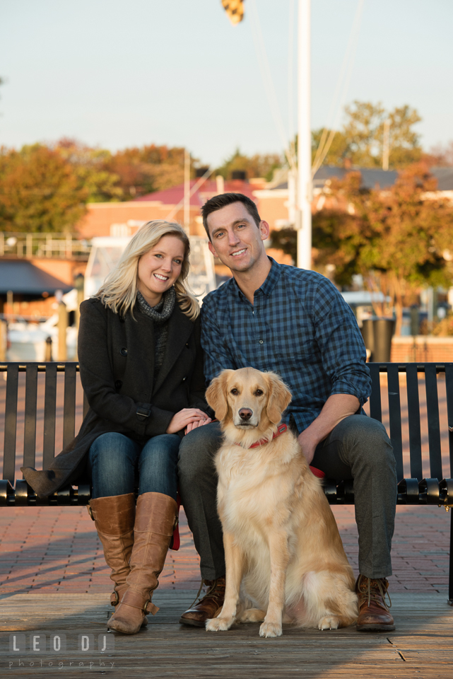 Downtown Annapolis Maryland engaged couple posing with their dog engagement photo by Leo Dj Photography.