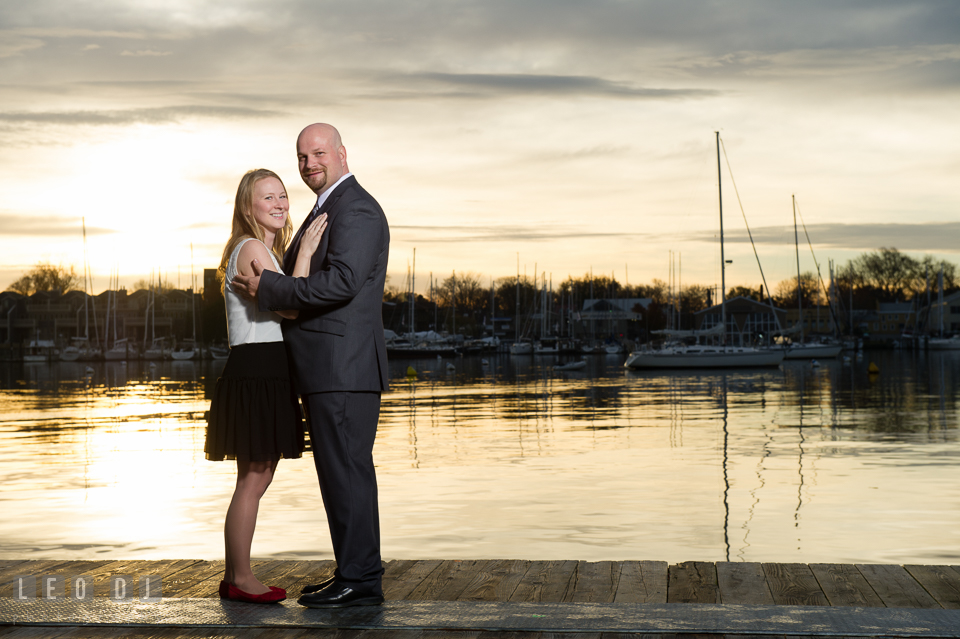 Downtown Annapolis Maryland engaged couple posing on boat dock photo by Leo Dj Photography.