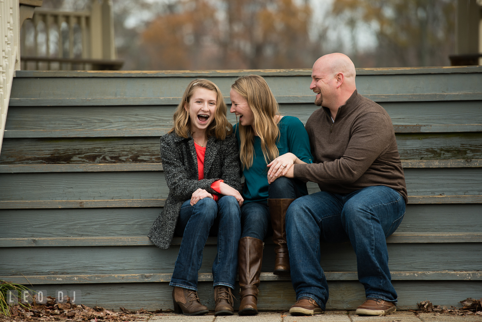 Quiet Waters Park Annapolis Maryland engaged girl with daughter and fiance laughing together photo by Leo Dj Photography.