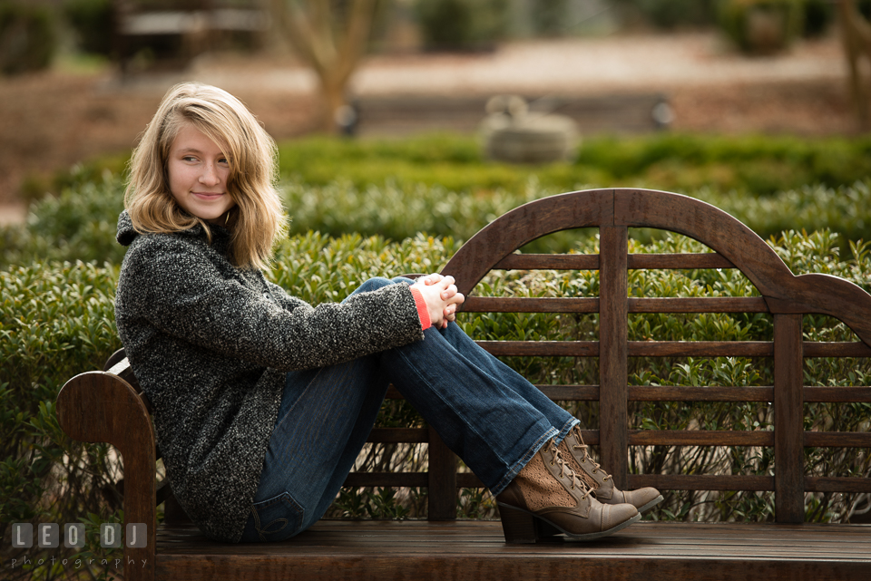 Quiet Waters Park Annapolis Maryland daughter of engaged couple lounging on bench photo by Leo Dj Photography.