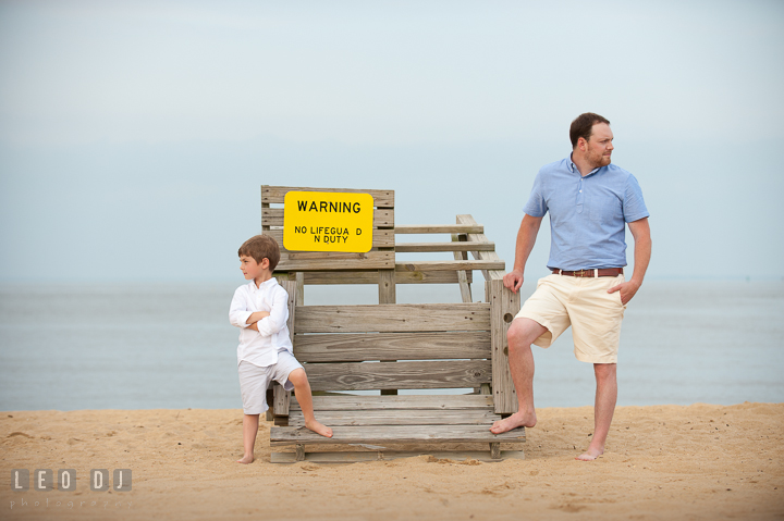 Father and son posing by a lifeguard post chair. Chesapeake Bay, Kent Island, Annapolis, Eastern Shore Maryland children and family lifestyle portrait photo session by photographers of Leo Dj Photography. http://leodjphoto.com