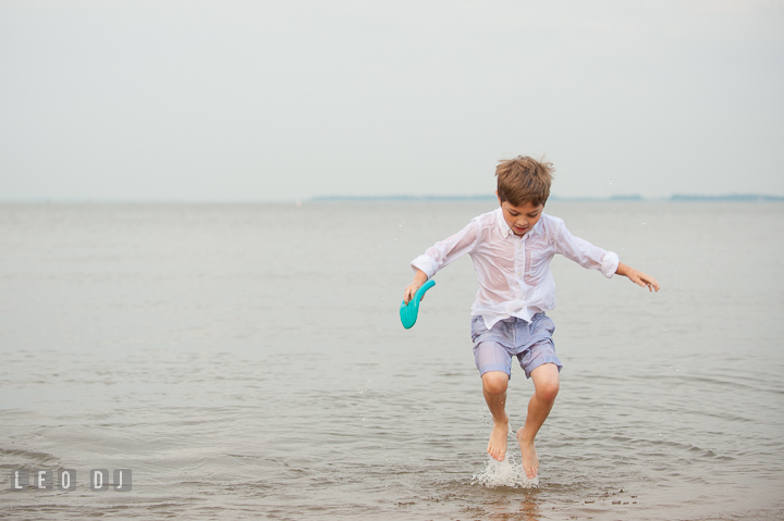 Young boy jumping on the water. Chesapeake Bay, Kent Island, Annapolis, Eastern Shore Maryland children and family lifestyle portrait photo session by photographers of Leo Dj Photography. http://leodjphoto.com
